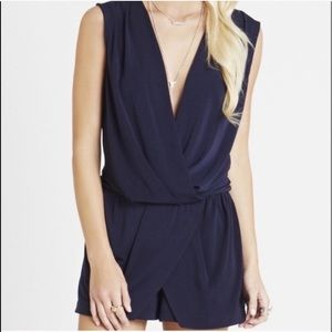 Bcbgeneration romper with faux wrap and deep v